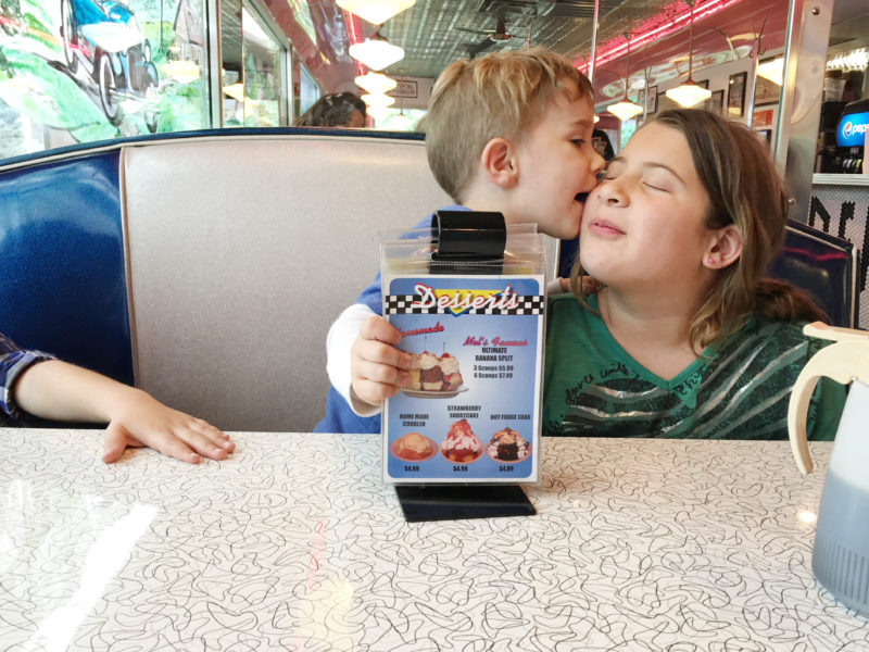 Pigeon Forge Family Fun Vacation Mel's Diner Sibling Kiss