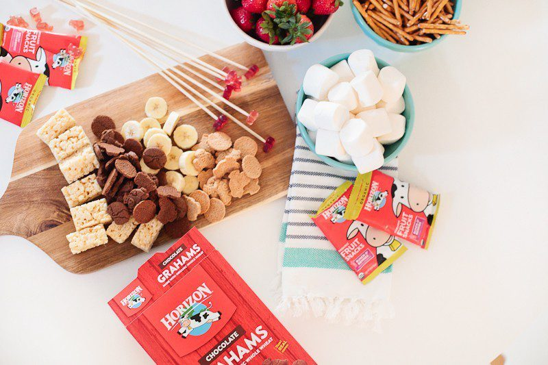 Kid Friendly Fondue Party - Just two simple ingredients gives you deliciously smooth chocolate fondue for your next party or after school snack and serve with your favorite snacks for a kid friendly fondue (fountain not required, but it is totally fun right?!)