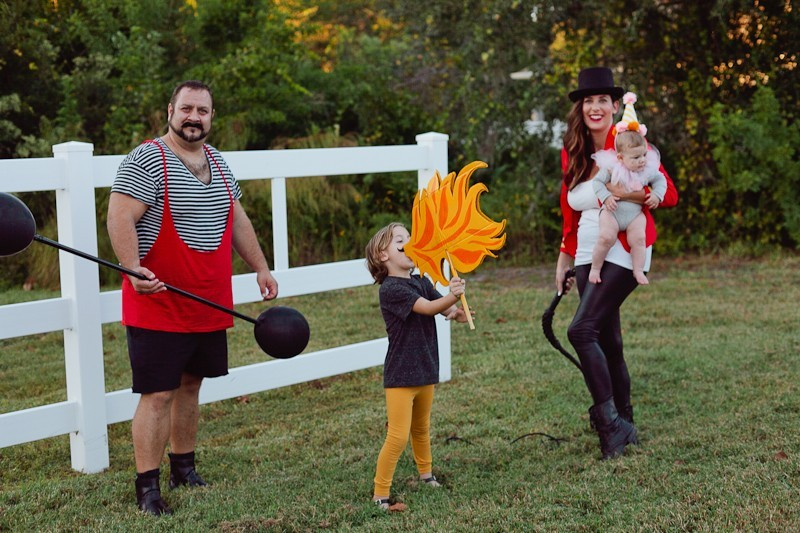 A DIY Family Circus Costume complete with Strong Man, Lion Tamer - Ring Master, Lion, Acrobat, Fire Breather and Clown! Get the full step by step on this family costume from popular Florida lifestyle blogger Tabitha Blue of Fresh Mommy Blog | Cute Halloween Family Costume Ideas featured by top Florida lifestyle blogger, Fresh Mommy Blog: Family Circus