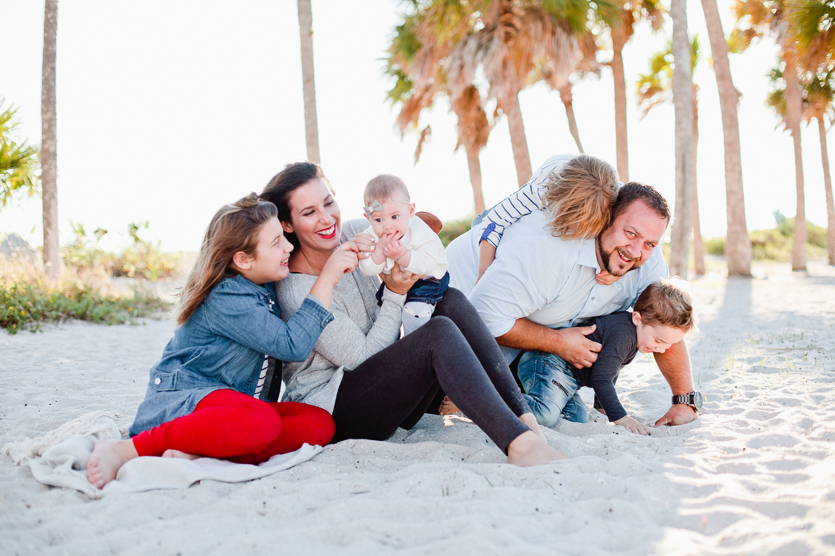 a frolicking fun family christmas card photo shoot at the beach - Family Photo Christmas Cards