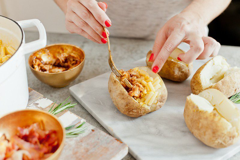 Mac and Cheese Stuffed Baked Potato. Top with BBQ chicken or bacon for a delicious twist on a classic meal.