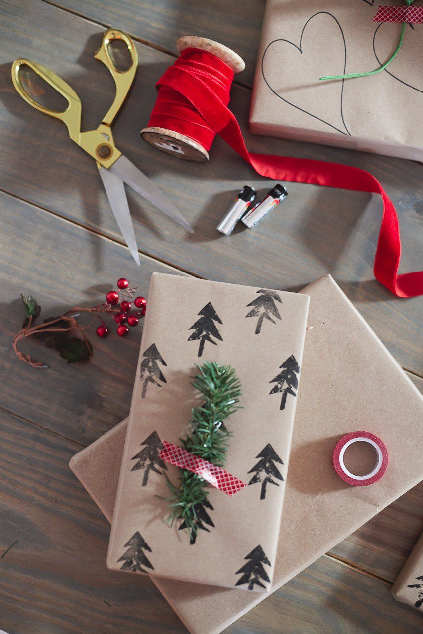Save time and money with this easy and simple Christmas gift wrap hack! Gift wrapping ideas you can't miss, like using a potato to stamp your customized design.  | The Simple and Easy Christmas Gift Wrapping Ideas You Can't Miss feeatured by top Florida life and style blog Fresh Mommy Blog