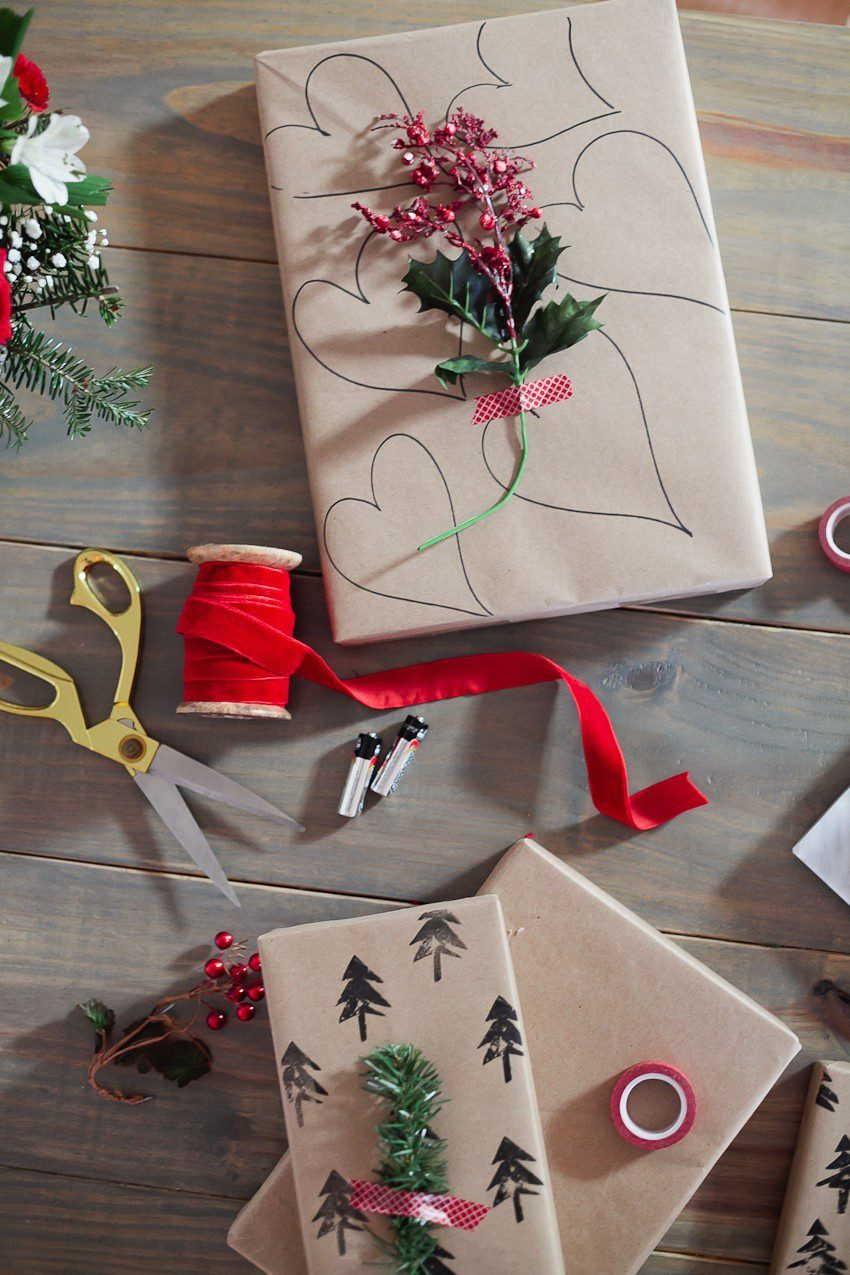 Save time and money with this easy and simple Christmas gift wrap hack! Gift wrapping ideas you can't miss, like using a potato to stamp your customized design.