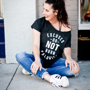 Who needs a little encouragement to burn those calories?! *Hand Raised* We all know it, and now we can SHARE it too. Excuses do NOT burn calories, but walking around in style in this new statement tee does!