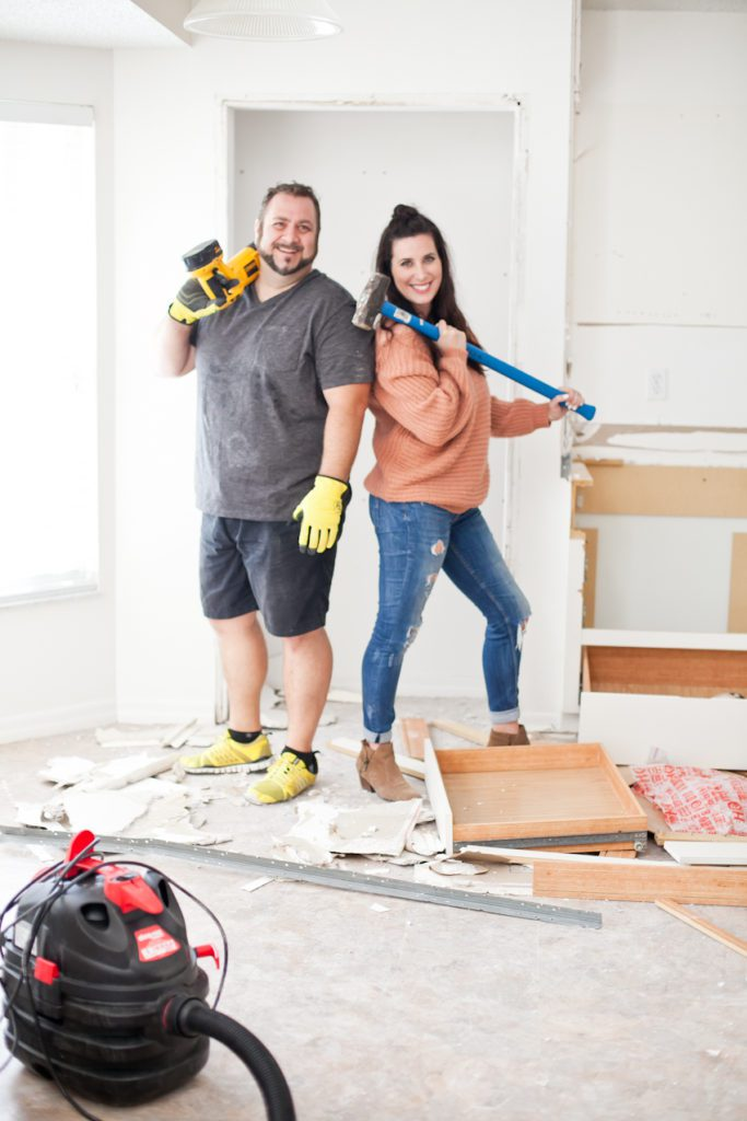 Home Improvement Projects featured by top US home improvement blog Fresh Mommy Blog; Image of husband and wife doing a home project.