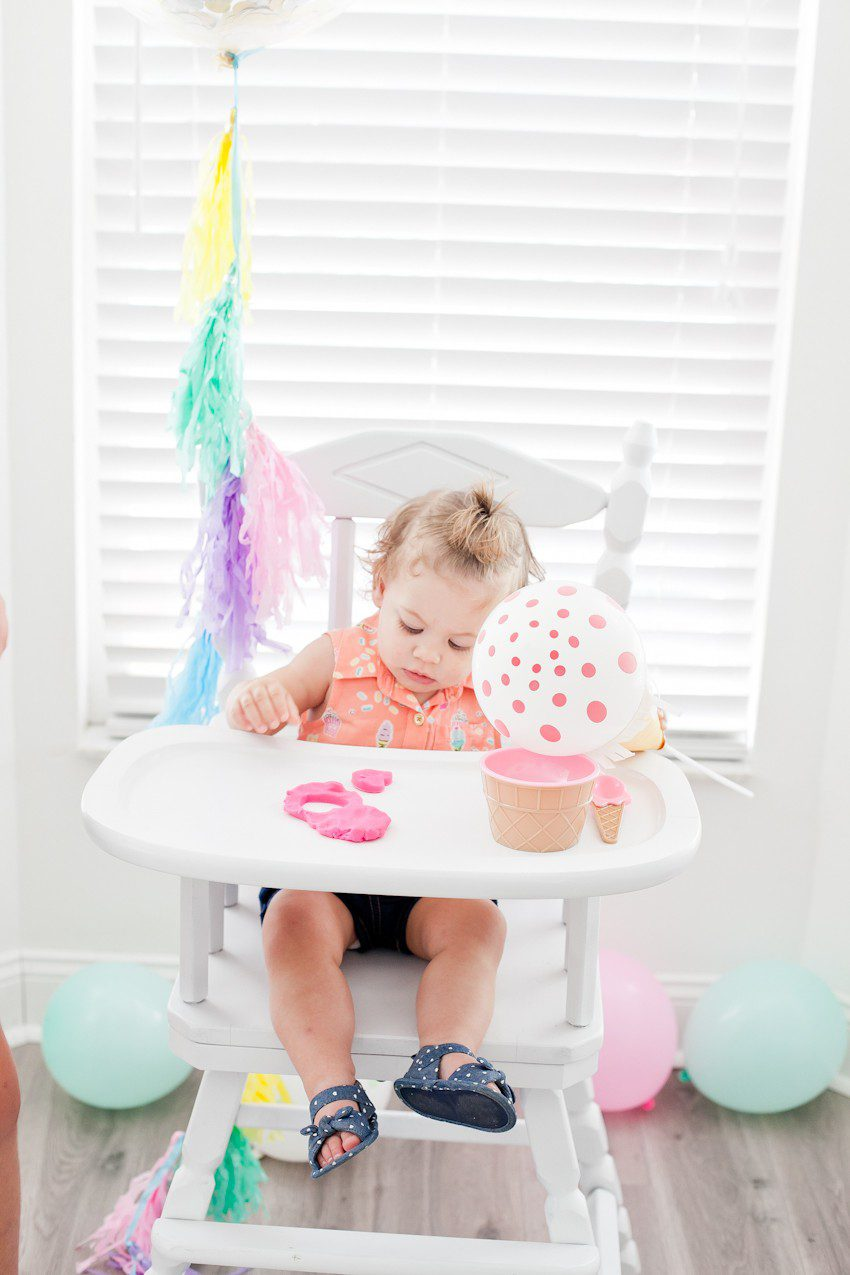 "Ice Cream Social Birthday Party with DIY Ice Cream Balloons, and ice cream cone ""spilled"" cake, Ice Cream bar with cookies for DIY ice cream cookies and more! So much sweetness for a sweet first birthday party!"