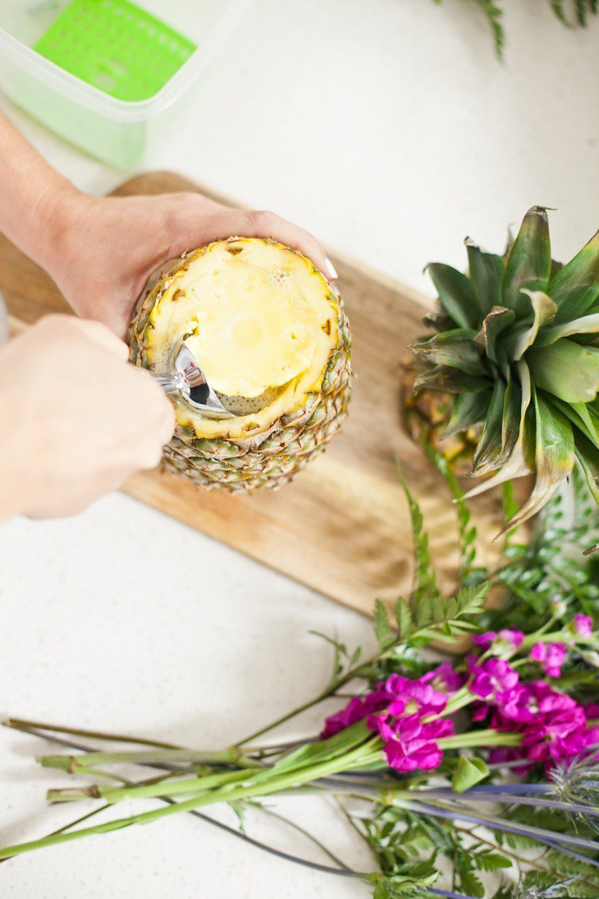 Pineapple Flower Arrangement for garden parties or a summer tropical fete! This DIY Pineapple vase is an easy to make centerpiece or perfect for a Tiki bar! - Tropical Pineapple Floral Arrangement featured by popular Florida lifestyle blogger Fresh Mommy Blog
