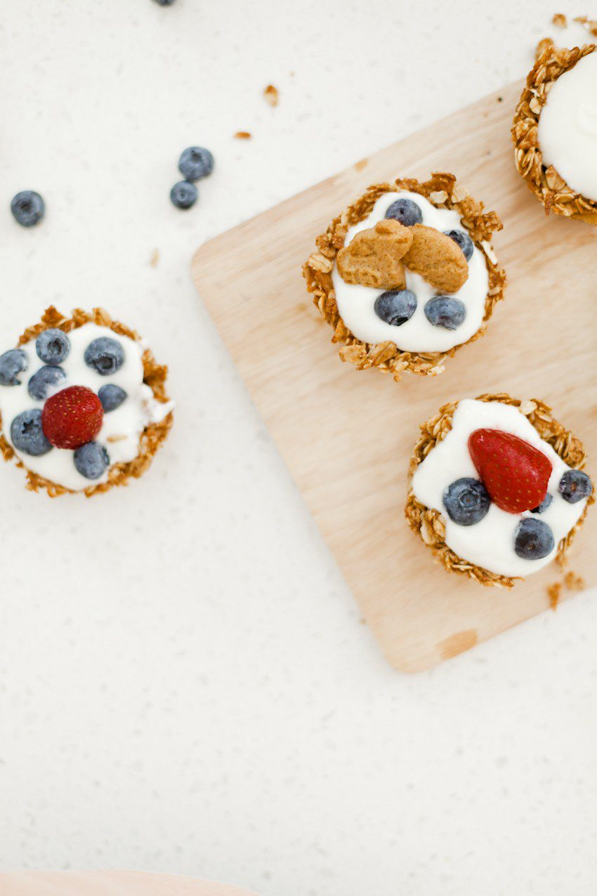 A parfait-style treat with a twist! Sweet, delicious, and crunchy granola cups exploding with flavor to hold all the goodies of a delicious parfait treat. Make these yogurt filled granola cups topped with fruit for breakfast, snacks or even serve as a dessert!