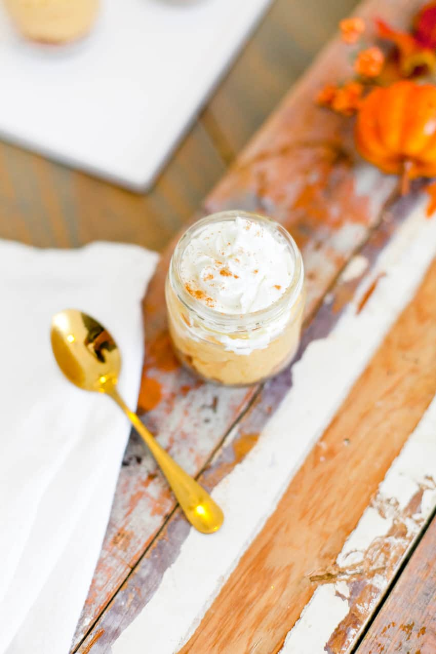 The best No Bake Pumpkin Cheesecake combines some of our favorite flavors of fall in a dish that's so simple to whip up, rich and creamy! Serve it in jars for an easy individual sharing.