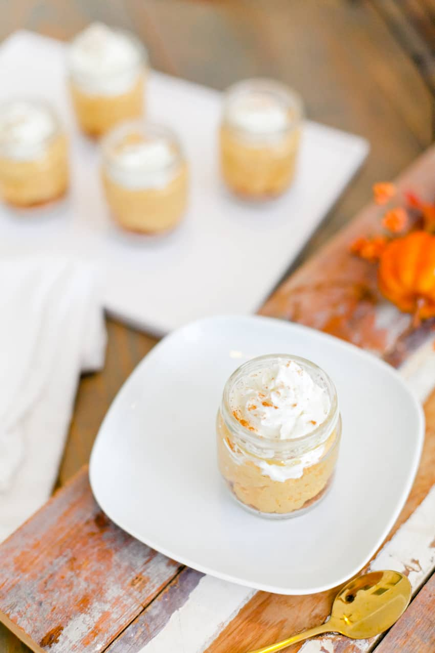 The best No Bake Pumpkin Cheesecake combines some of the favorite flavors of fall! Serve this pumpkin dessert jar for an easy individual serving! Perfect for desserts, parties, fall events and more.