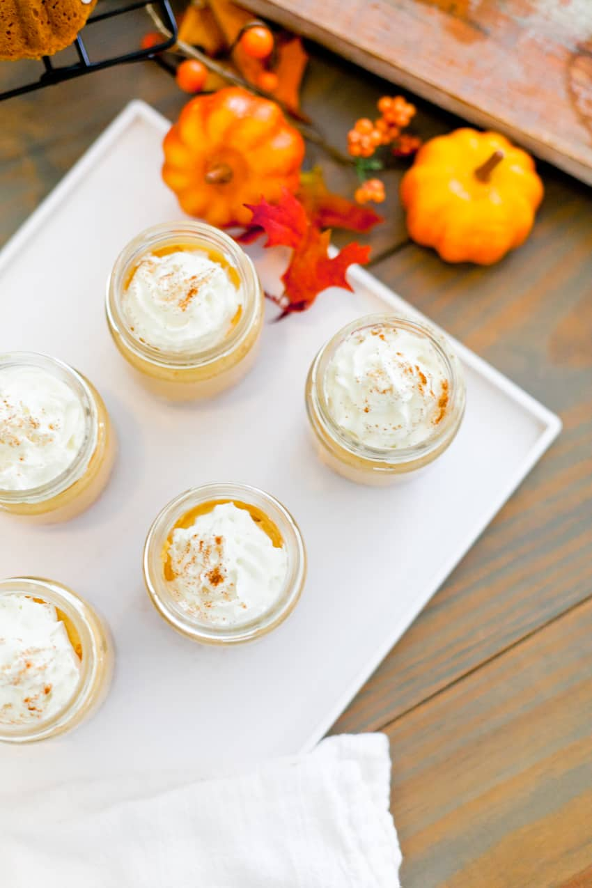 The best No Bake Pumpkin Cheesecake combines some of the favorite flavors of fall! Serve it in jars for an easy individual serving! Perfect for desserts, parties, fall events and more.