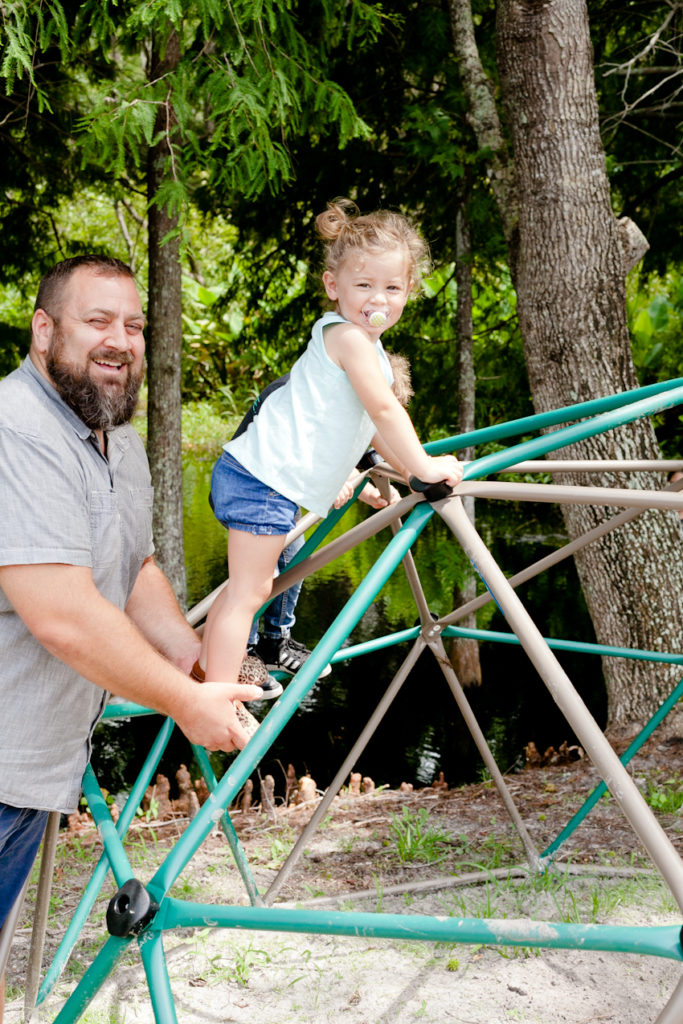 Home Improvement Projects featured by top US home improvement blog Fresh Mommy Blog; Image of a father and daughter playing in the backyard.