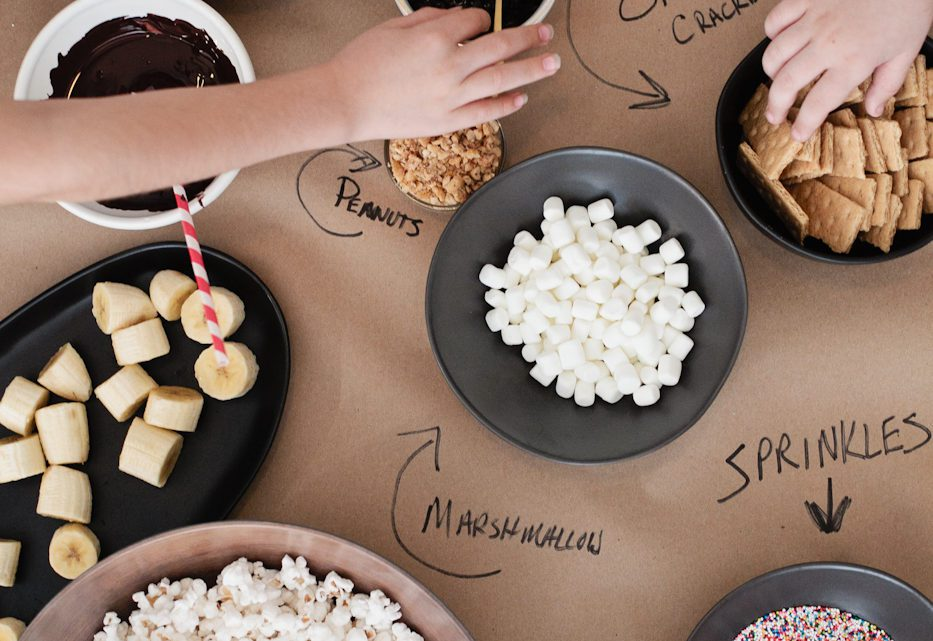 The Best Sleepover Party Snacks. Snacking Table with Popcorn and more.