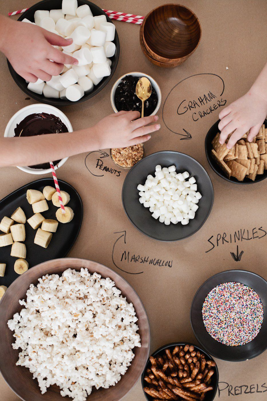The Best Sleepover Party Snacks: Snacking Table with Popcorn and more featured by top Florida lifestyle blog, Fresh Mommy Blog