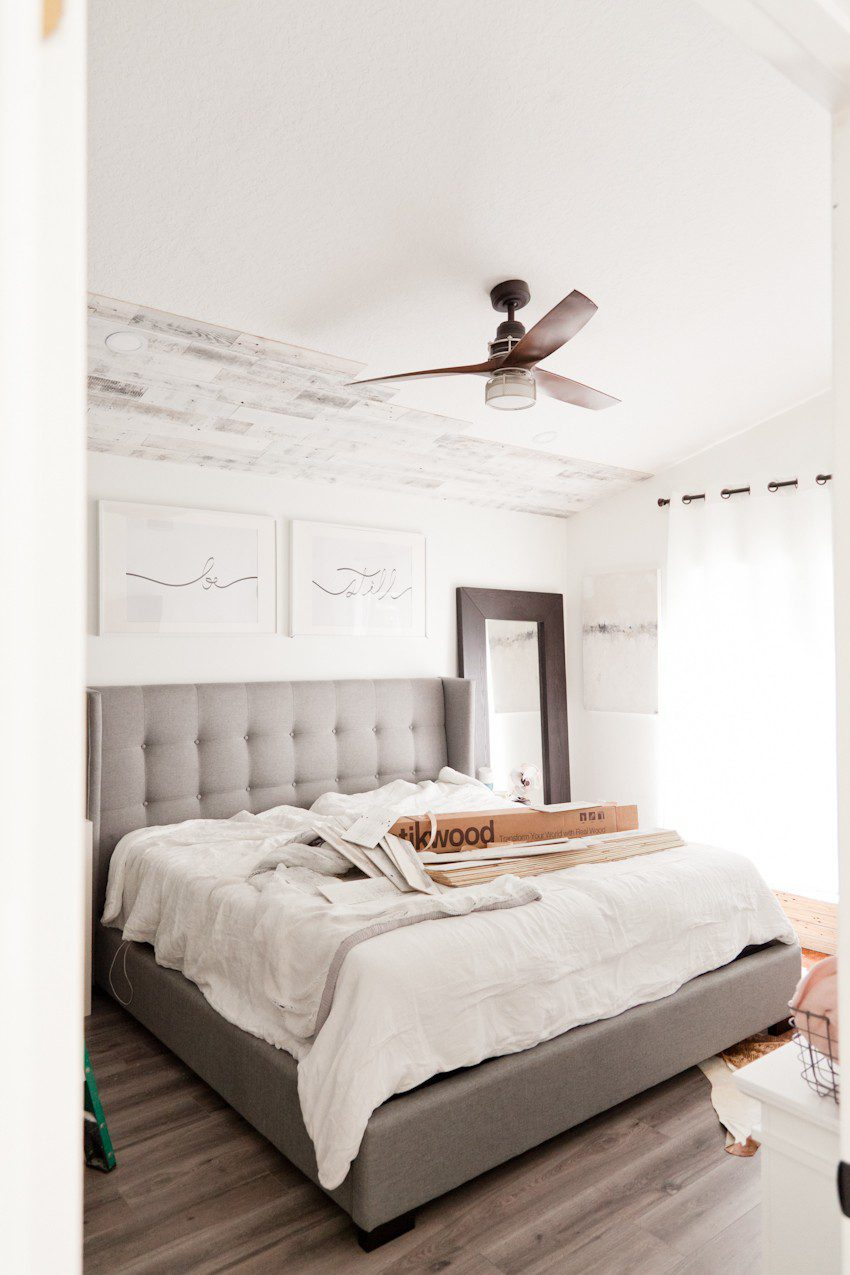 How to Install your Own Reclaimed Wood Ceiling - Master Bedroom Update featured by top Florida lifestyle blog, Fresh Mommy Blog: woman installing reclaimed wood ceiling in her master bedroom