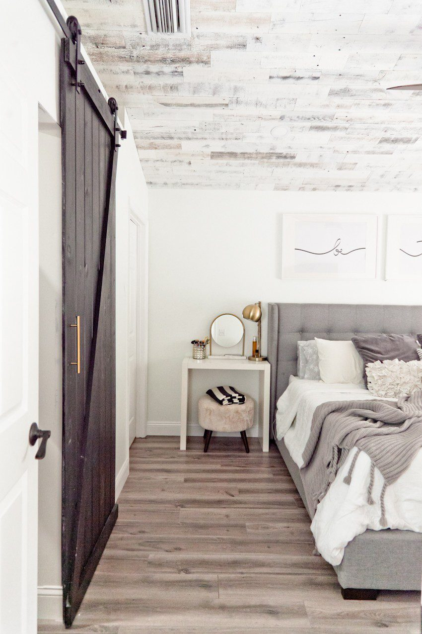 How to Install your Own Reclaimed Wood Ceiling - Master Bedroom Update featured by top Florida lifestyle blog, Fresh Mommy Blog: picture of a bed, sliding doors and bedside table
