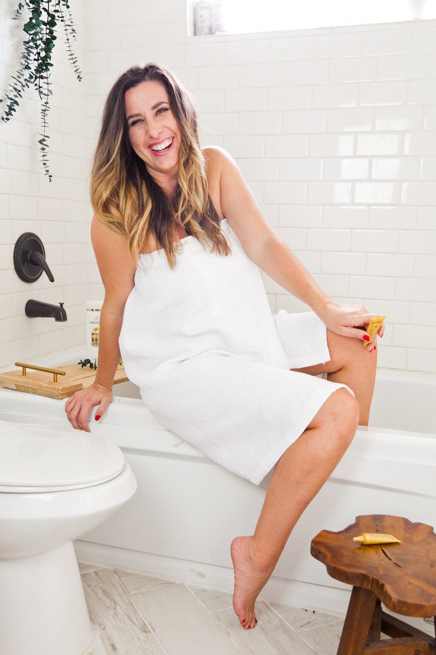 Top Florida life and style blog, Fresh Mommy Blog, features their Winter Hair Care tips: image of a woman in her bathroom