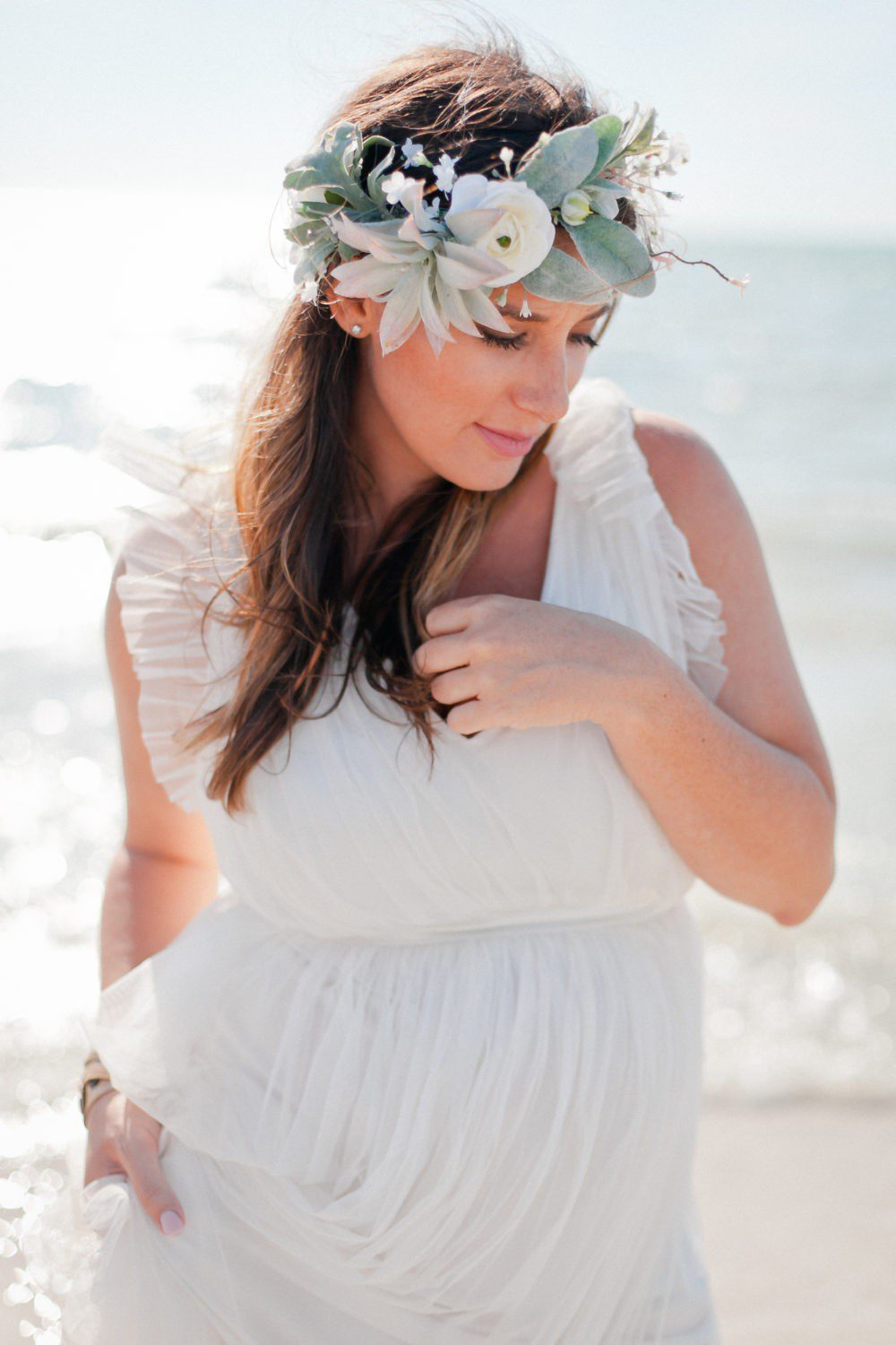 15 Years of Marriage featured by top US lifestyle blog Fresh Mommy Blog; Image of a woman wearing a white dress on the beach.