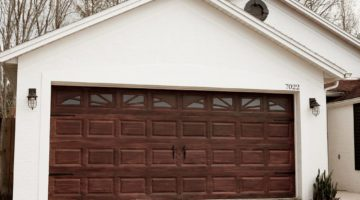 Tips for a DIY Garage Door Makeover and how to Gel Stain a Garage Door to Look Like Wood by popular lifestyle blogger Tabitha Blue of Fresh Mommy Blog: image of white house with faux wood garage door.