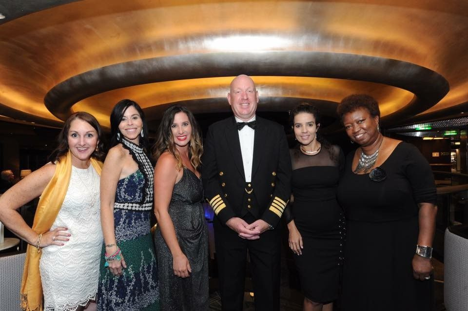 5 Amazing Reason to go on a Holland America cruise with Oprah Magazine by popular US lifestyle blog Fresh Mommy Blog: image of 5 women in evening wear standing with the captain of Holland America cruise ship.