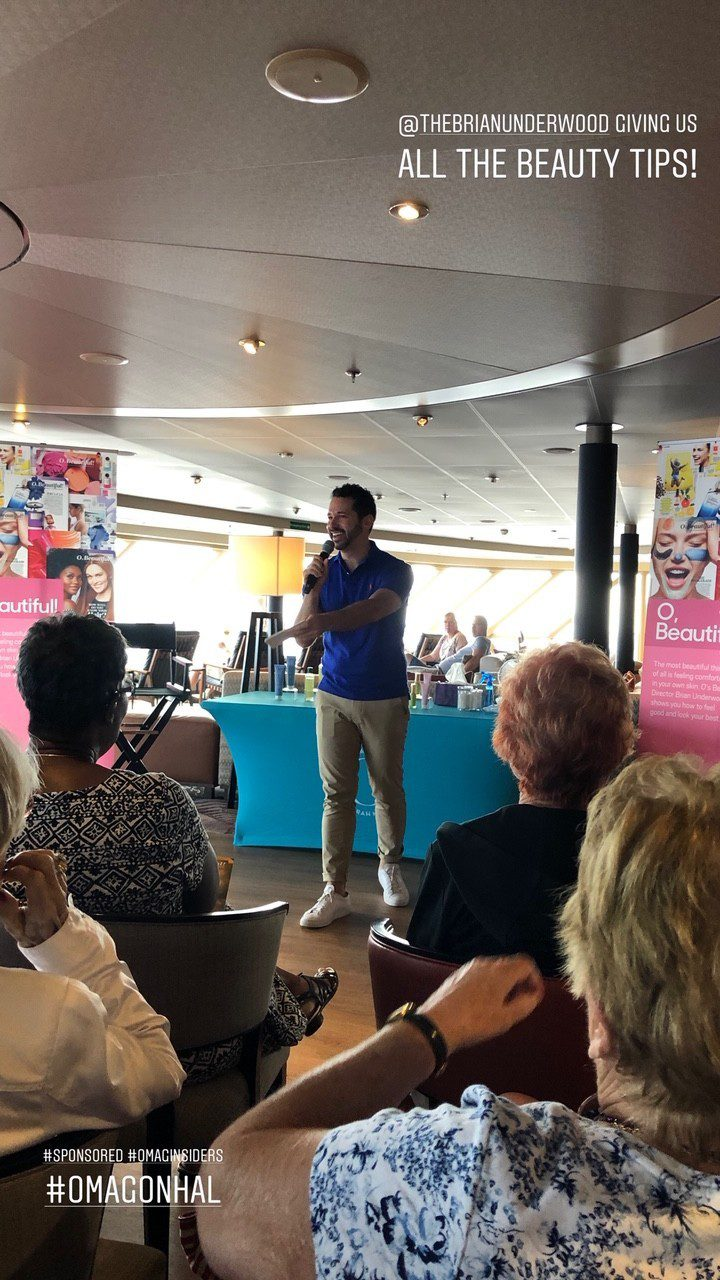 5 Amazing Reason to go on a Holland America cruise with Oprah Magazine by popular US lifestyle blog Fresh Mommy Blog: image of Brian Underwood standing in front of a group of women and giving a presentation.