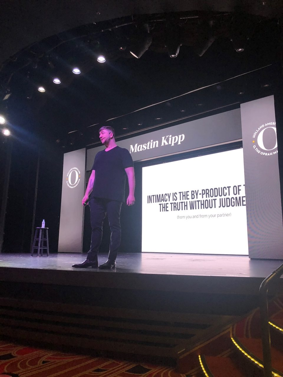 5 Amazing Reason to go on a Holland America cruise with Oprah Magazine by popular US lifestyle blog Fresh Mommy Blog: image of Mastin Kipp standing on stage and giving a presentation.
