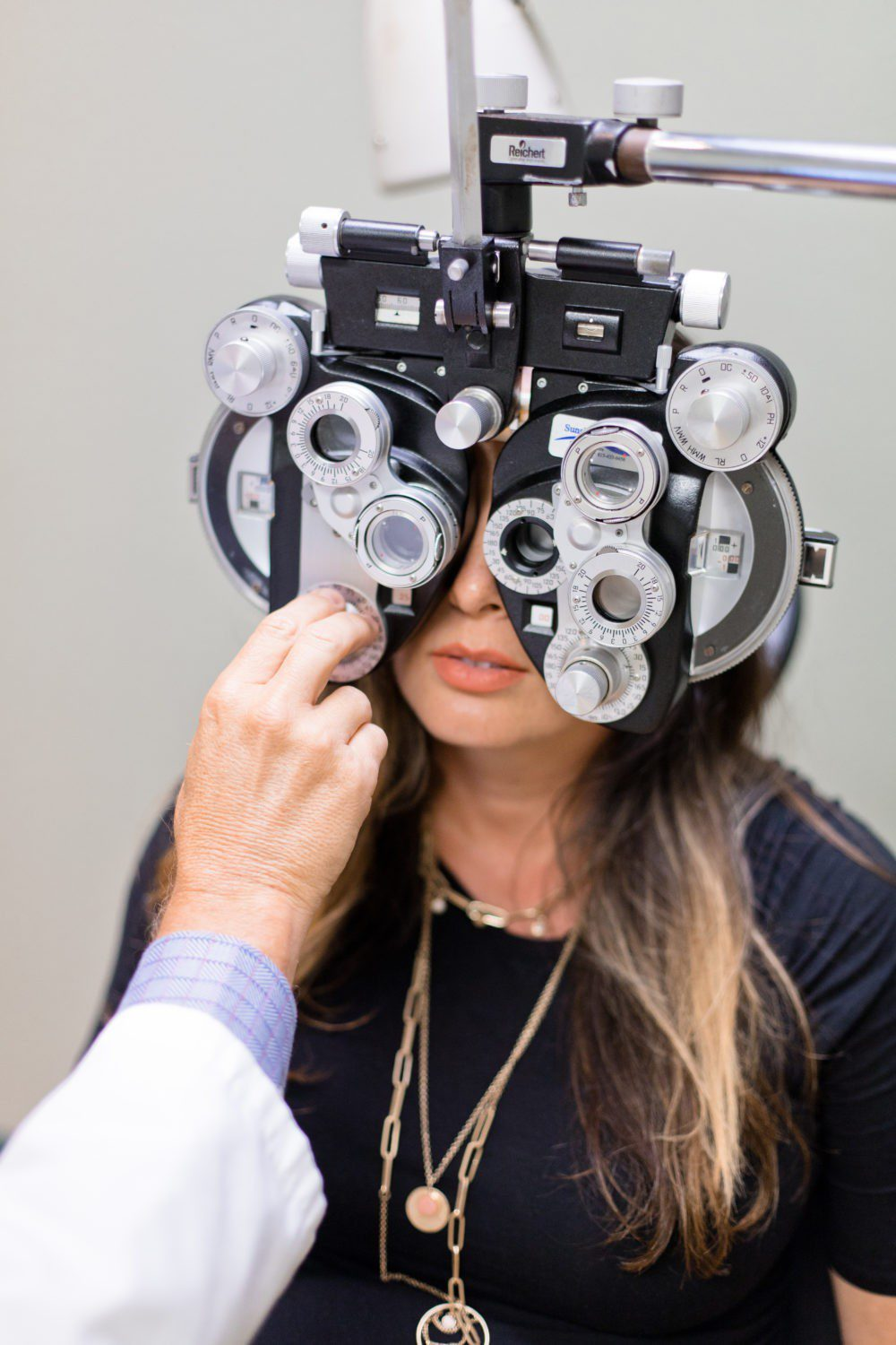 Back to School Eye Exam: How to Prepare your Child for a Successful Academic Year | Back to School Eye Exam: How to Prepare your Child for a Successful Academic Year by popular Florida lifestyle blog, Fresh Mommy Blog: image of a woman getting her eyes examined by an eye doctor.