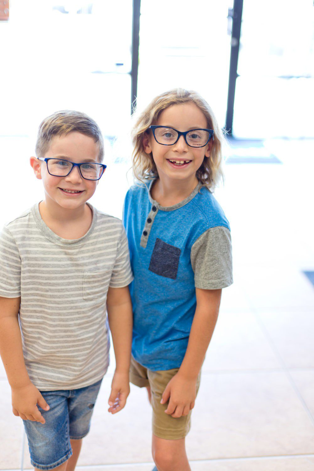 Back to School Eye Exam: How to Prepare your Child for a Successful Academic Year | Back to School Eye Exam: How to Prepare your Child for a Successful Academic Year by popular Florida lifestyle blog, Fresh Mommy Blog: image of two young boys wearing glasses.