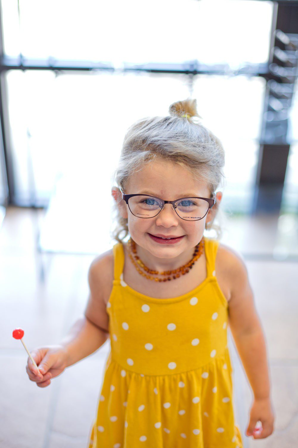 Back to School Eye Exam: How to Prepare your Child for a Successful Academic Year | Back to School Eye Exam: How to Prepare your Child for a Successful Academic Year by popular Florida lifestyle blog, Fresh Mommy Blog: image of a young girl wearing a pair of glasses.