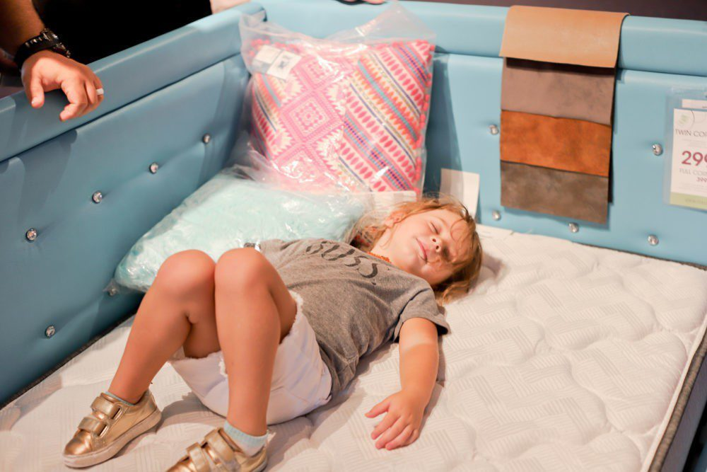 6 Best Tips to Transition Your Child from Crib to Toddler Bed: Aria's Big Girl Bed | 6 Best Tips to Transition Your Child from Crib to Toddler Bed: Aria's Big Girl Bed by popular Florida lifestyle blog, Fresh Mommy: image of a little girl laying a twin bed.