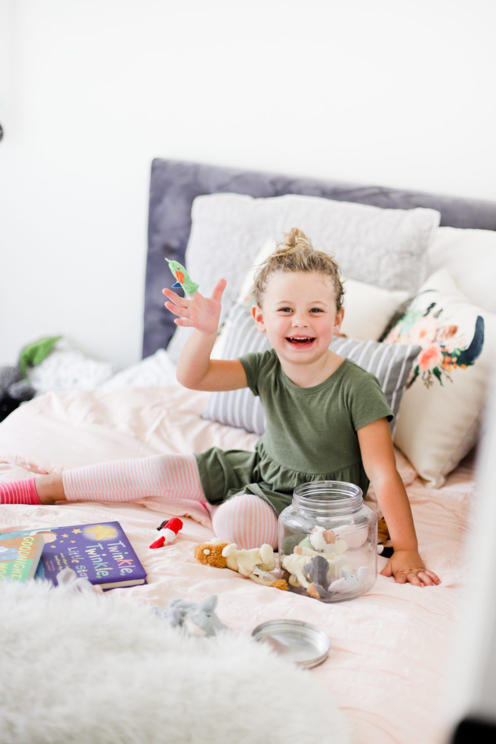 6 Best Tips to Transition Your Child from Crib to Toddler Bed: Aria's Big Girl Bed | 6 Best Tips to Transition Your Child from Crib to Toddler Bed: Aria's Big Girl Bed by popular Florida lifestyle blog, Fresh Mommy: image of a little girl sitting on her twin size bed.