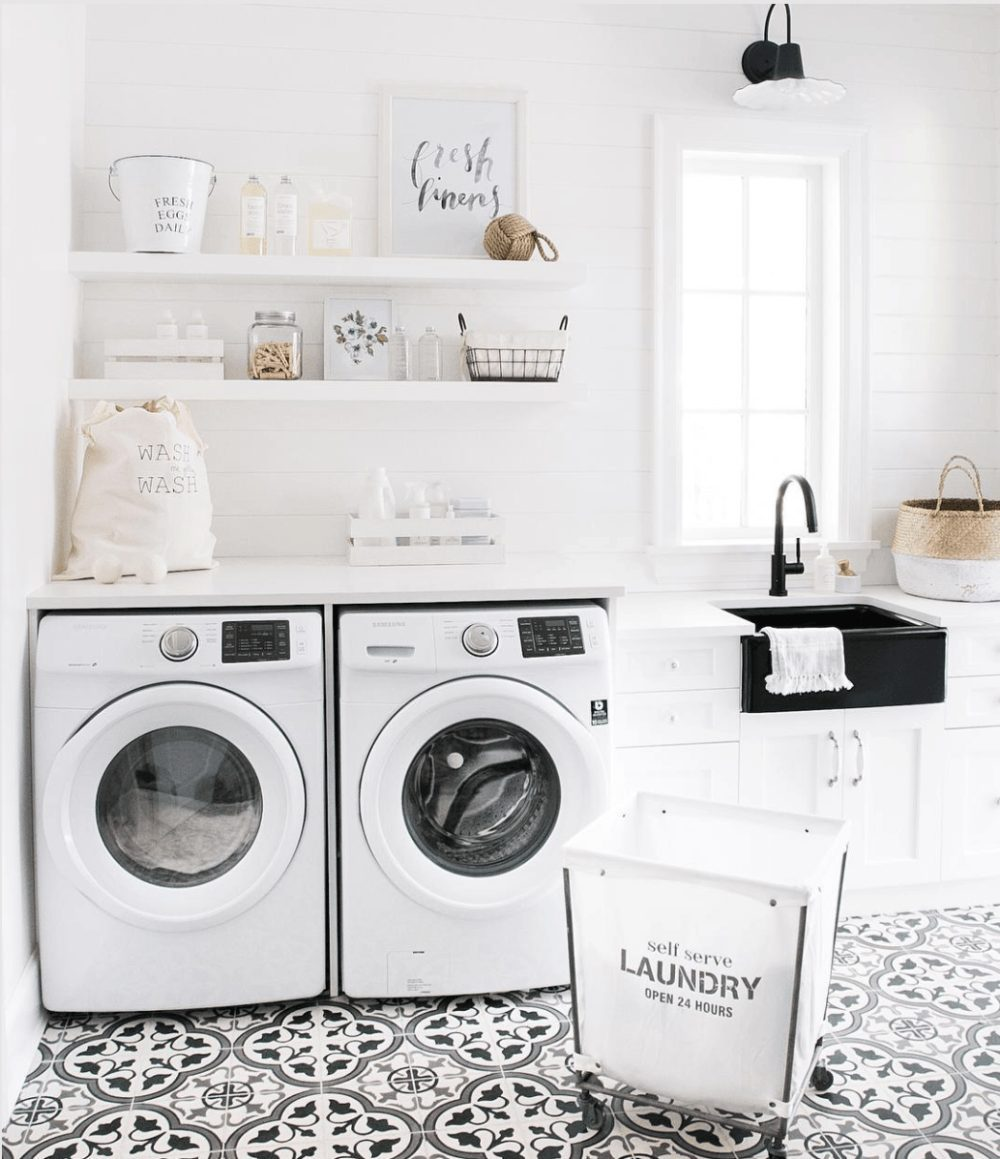 Laundry Room Makeover Ideas! Design plans and ideas for creating a family friendly laundry room. | Contemporary Laundry Room Ideas: A Light + Modern Design Plan by popular Florida lifestyle blog, Fresh Mommy: image of a remodeled laundry room.