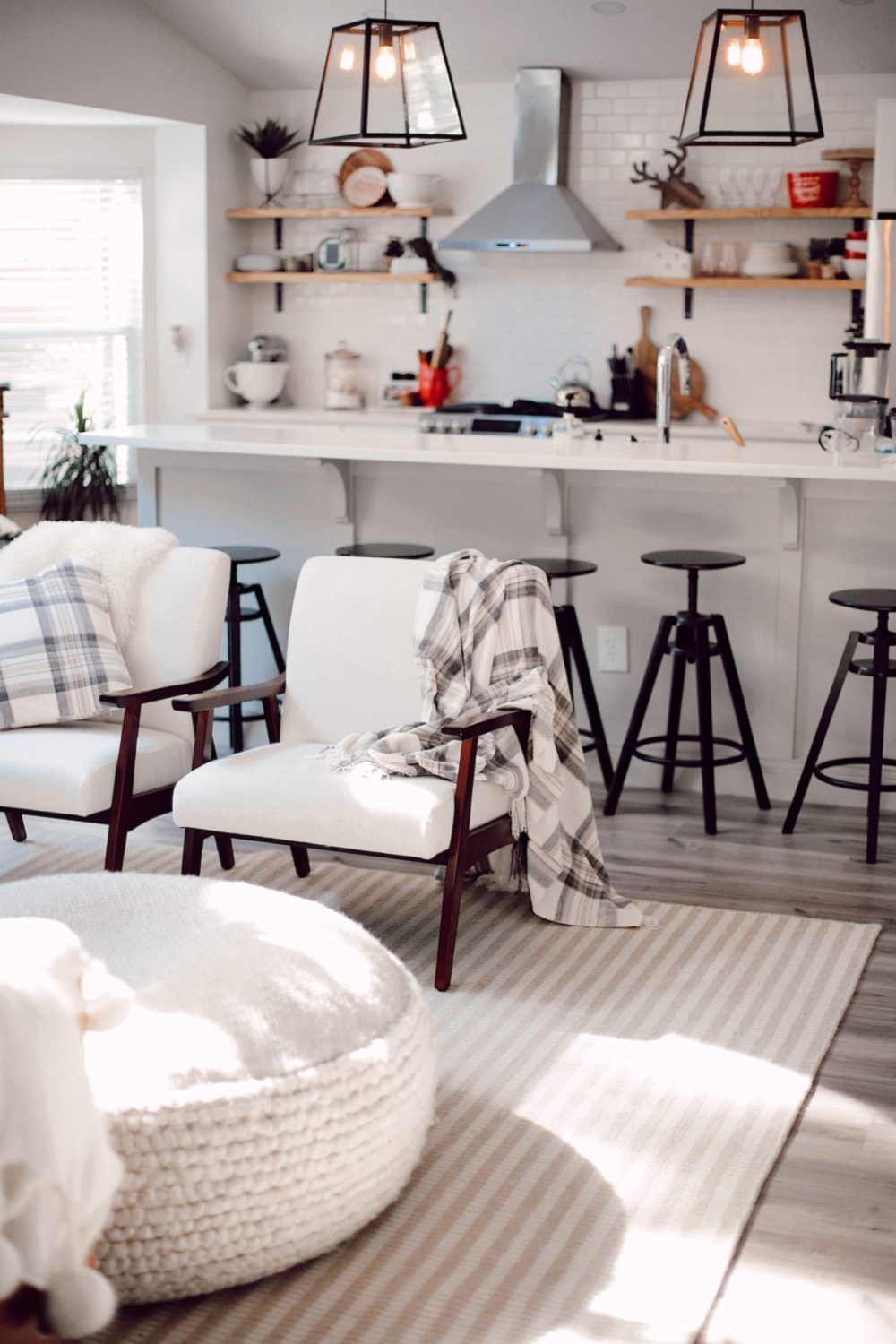 7 Geniously Efficient Mom Hacks for Home Design | 7 Genius Efficient Home Design Hacks for Moms by popular Florida life and style blog, Fresh Mommy Blog: image of a neutral colored kitchen and living room with furniture from CORT furniture outlet.
