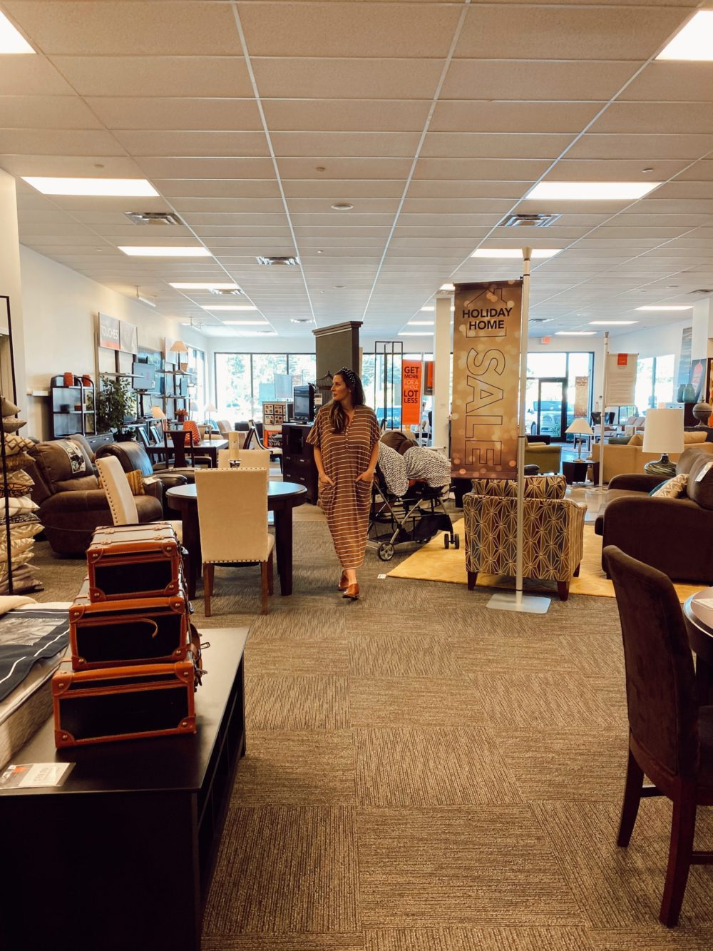 7 Geniously Efficient Mom Hacks for Home Design | 7 Genius Efficient Home Design Hacks for Moms by popular Florida life and style blog, Fresh Mommy Blog: image of a mom walking through CORT furniture outlet.