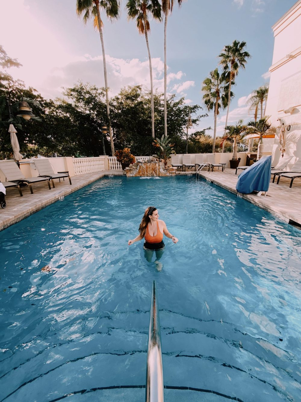 Bayfront Inn 5th Avenue in Naples, Marco Island and the Everglades - Florida's Paradise Coast | Spectacular Things to Do in Naples FL This Weekend by popular Florida blog, Fresh Mommy Blog: image of a woman in a swimming pool at Bayfront Inn.