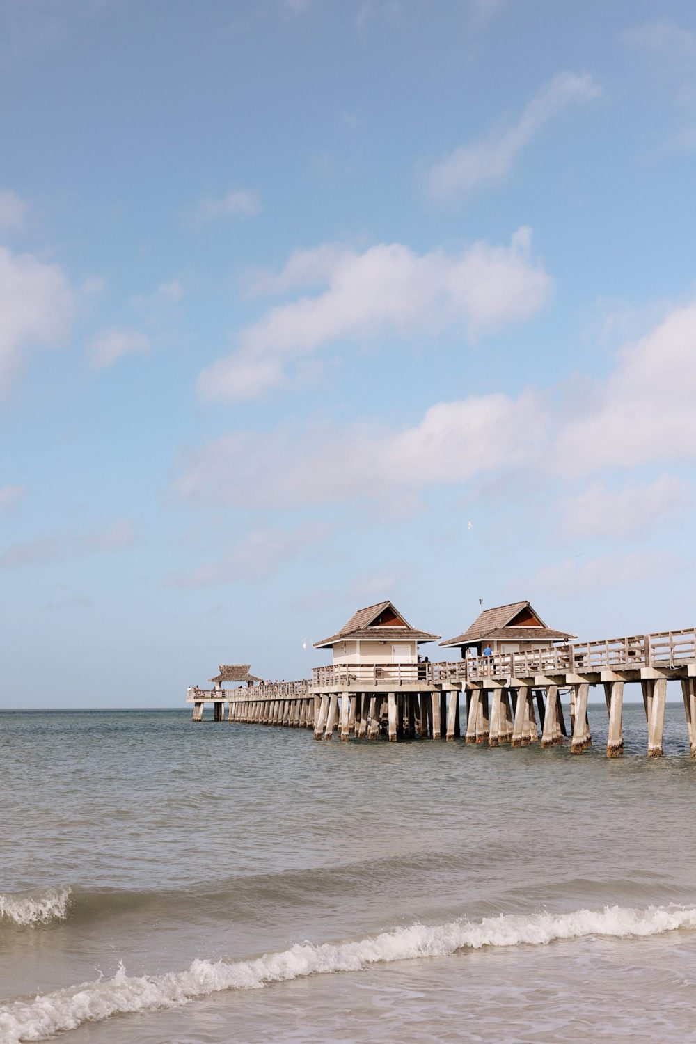 Vacation well in Paradise at the historic landmark Naples Pier. Naples, Marco Island and the Everglades - Florida's Paradise Coast | Spectacular Things to Do in Naples FL This Weekend by popular Florida blog, Fresh Mommy Blog: image of Naples pier.
