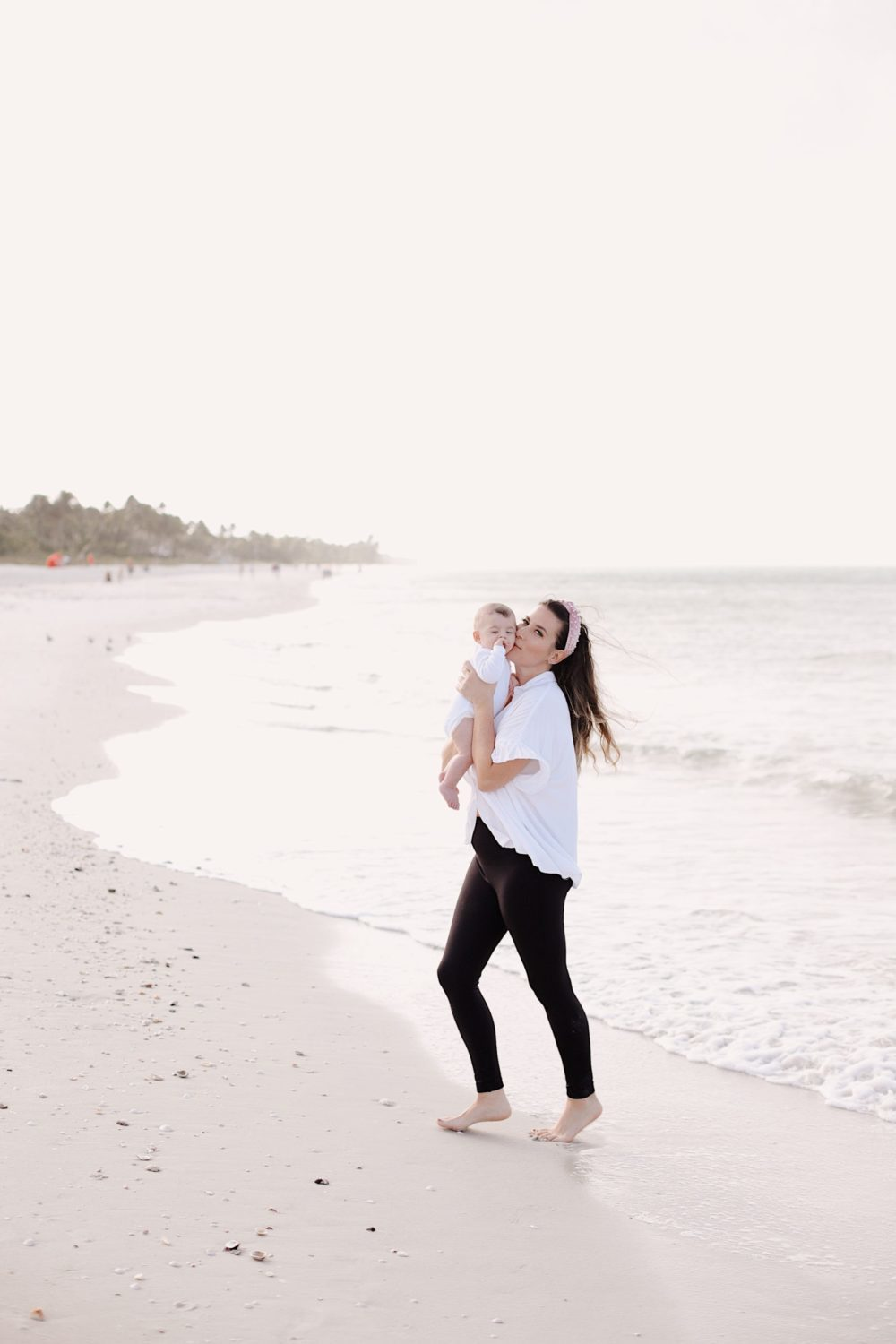 Spectacular Things to Do in Naples This Weekend | Spectacular Things to Do in Naples FL This Weekend by popular Florida blog, Fresh Mommy Blog: image of a woman holding her baby on the beach.