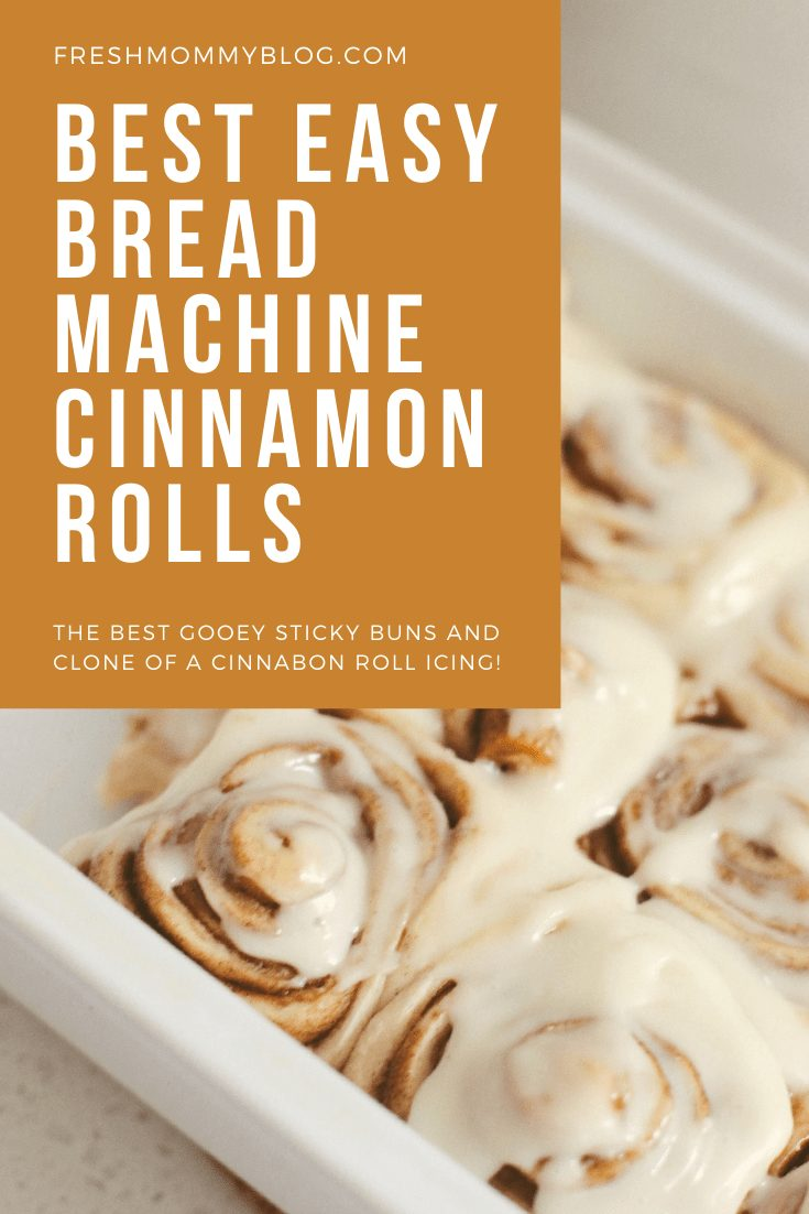 Bread Machine Cinnamon Roll Recipe by popular Florida lifestyle blog, Fresh Mommy Blog: image of cinnamon rolls in a white ceramic baking dish next to a bowl of cream cheese icing.