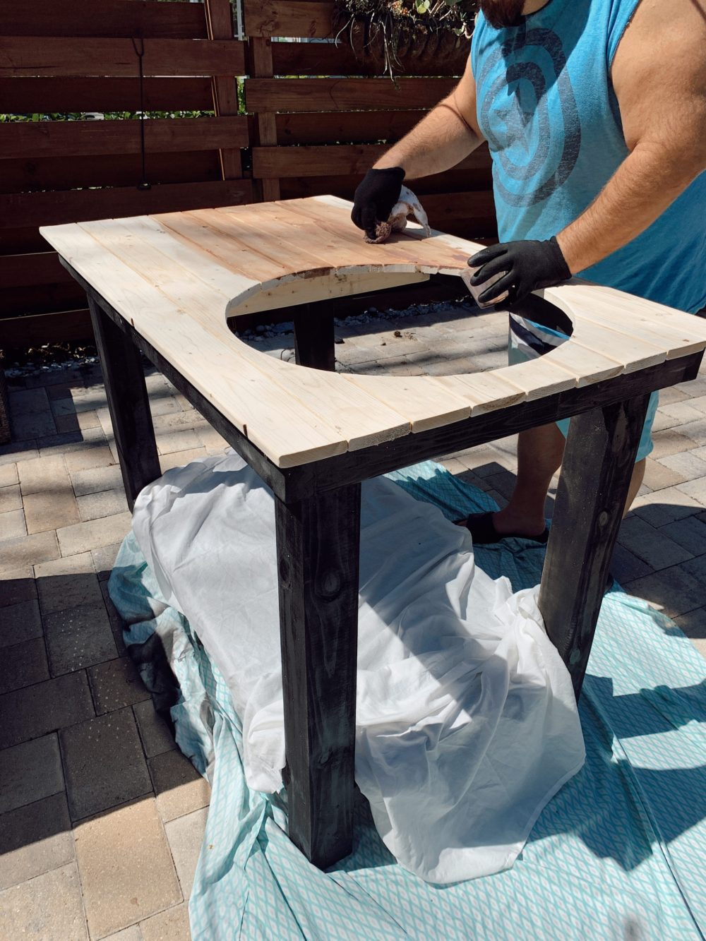Outdoor Grill Table DIY and Plans for How To Build a Mobile Grill Cart | DIY BBQ Table by popular Florida lifestyle blog, Fresh Mommy Blog: image of a man making a DIY BBQ table.