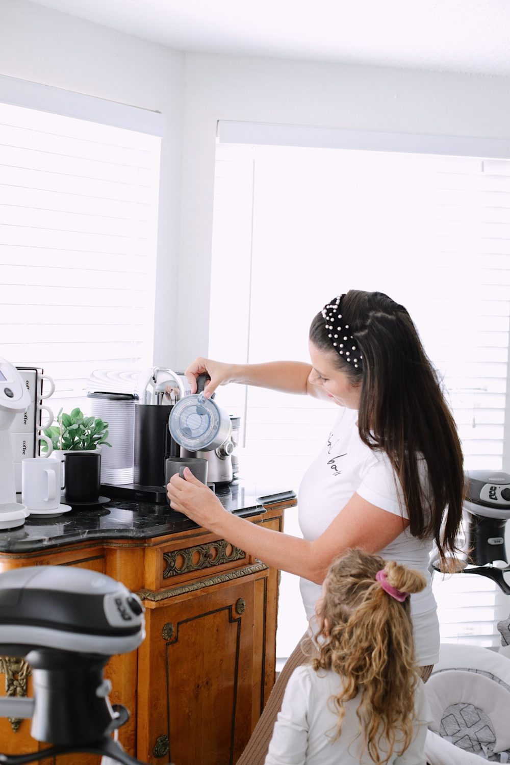 How to Survive Working With Kids at Home - Create your favorite coffee shop copy cat latte recipe in your own kitchen while working from home. | Working From Home With Kids by popular Florida lifestyle blog, Fresh Mommy Blog: image of a woman using her Breville coffee milk frother.