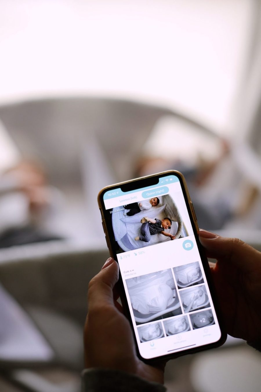 Best Baby Monitor by popular Florida motherhood blog, Fresh Mommy Blog: image of a mom using the Cubo Ai app on her smart phone.
