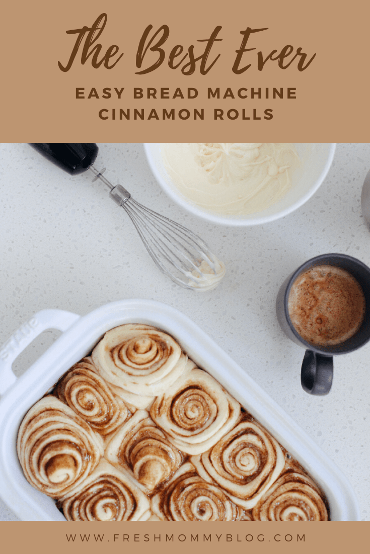 Easy bread machine cinnamon rolls dough. The best gooey sticky buns and clone of a Cinnabon roll icing! NO waiting overnight. Click for the recipe and how to video for fluffy cinnamon rolls homemade with a bread maker machine! Use all purpose flour or make them gluten free. Recipe from top Florida lifestyle blogger Tabitha Blue of Fresh Mommy Blog. | Bread Machine Cinnamon Roll Recipe by popular Florida lifestyle blog, Fresh Mommy Blog: Pinterest image of cinnamon rolls in a white ceramic baking dish next to a bowl of cream cheese icing.
