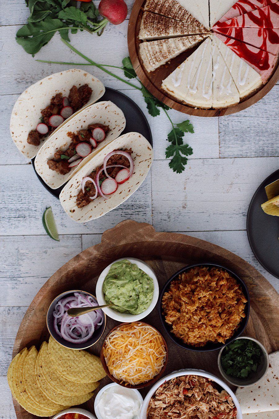 How to make an epic taco board and taco party platter tips! Plus, the best slow cooker taco chicken recipe! | Chicken Tacos by popular Florida lifestyle blog, Fresh Mommy Blog: image of pork barbacoa tacos, chicken taco platter, and cheesecake sampler.