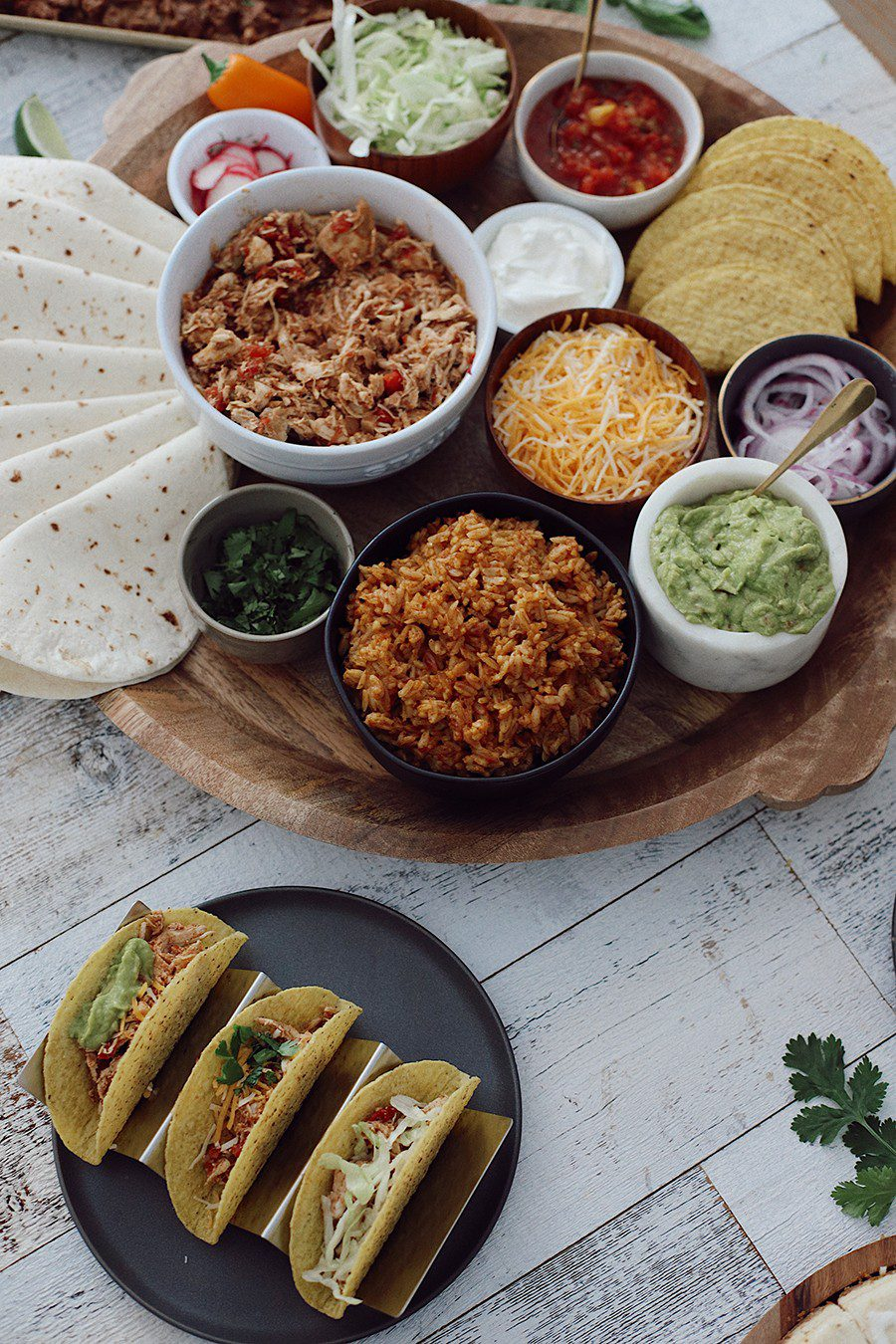 How to make an epic taco board and taco party platter tips! Plus, the best slow cooker taco chicken recipe! | Chicken Tacos by popular Florida lifestyle blog, Fresh Mommy Blog: image of a Chicken Tacos platter.