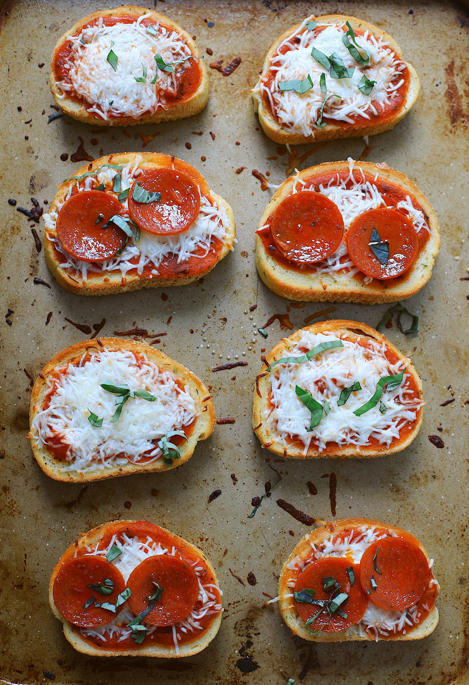 Simple and Easy Dinner Idea for the family! Whether Vegetarian or a meat lover, you can't go wrong with this garlic toast pizza recipe! Start with just 3 ingredients for a #preplessmeals dinner idea, and even the kids can make it! Frozen garlic toast (we're sharing a few options if you don't have it on-hand), #Prego Traditional Italian Tomato Sauce and mozzarella cheese make for a simple and delicious meal any time of day. Add in some pepperoni or other toppings and some fresh herbs to create any flavor combination or use up leftovers. Perfect for a quick lunch or dinnertime ideas when you're short on time.