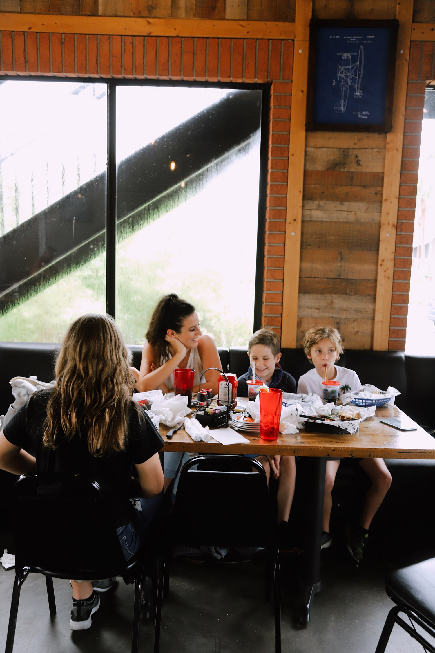 Spectacular Lake County, Florida Staycation Ideas for the Family! | Lake County by popular Florida blog, Fresh Mommy Blog: image of a family eating food at Puddle Jumpers.