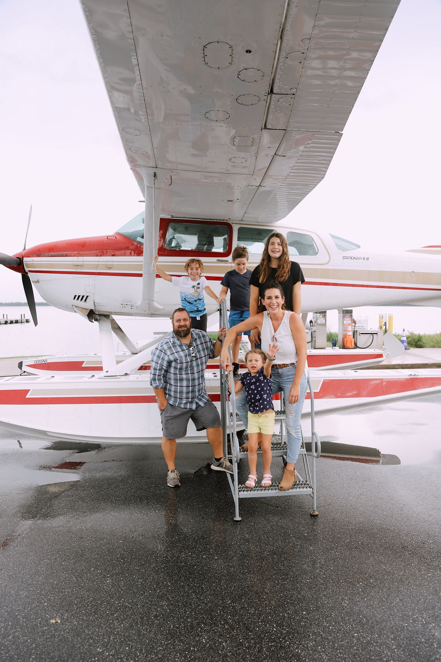 Spectacular Lake County, Florida Staycation Ideas for the Family! Jones Brothers Seaplane in Seaplane City | Lake County by popular Florida blog, Fresh Mommy Blog: image of a family standing next to a sea plane.