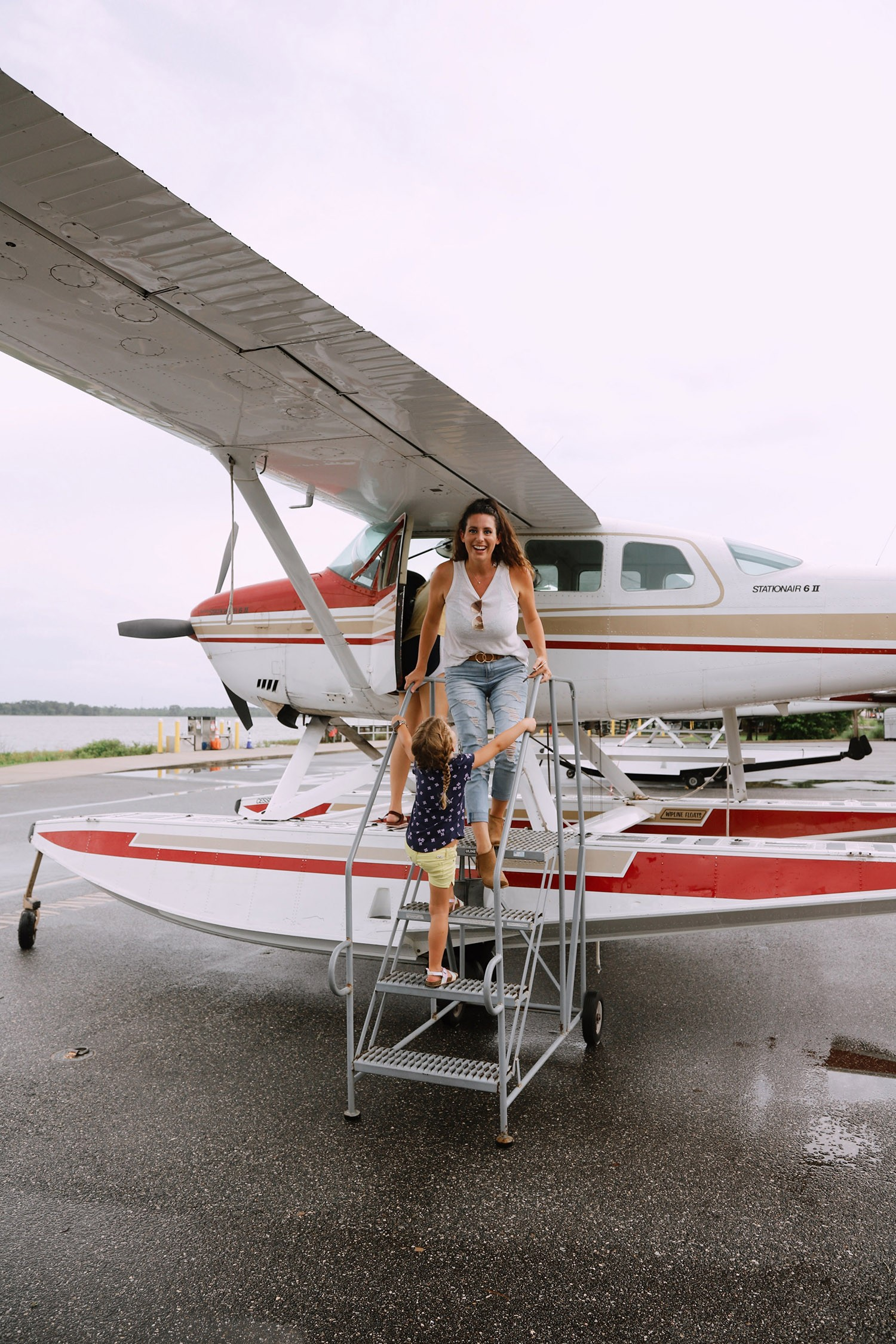 Spectacular Lake County, Florida Staycation Ideas for the Family! | Lake County by popular Florida blog, Fresh Mommy Blog: image of a mom and her young daughter standing next to a sea plane.