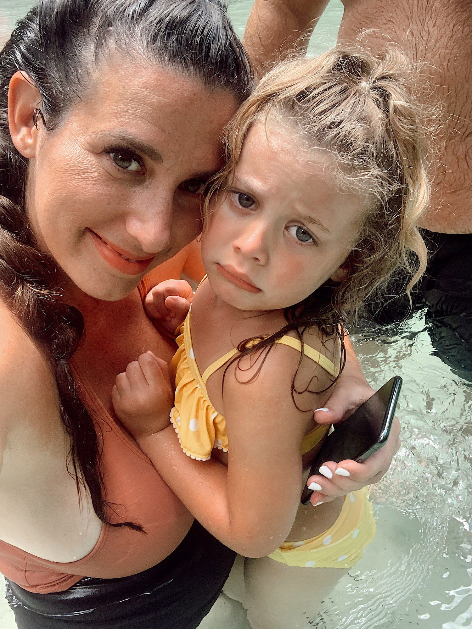 Tips for an Amazing Weeki Wachee Kayaking Florida Staycation. Visit Florida Travel ideas from top lifestyle blogger Tabitha Blue of Fresh Mommy Blog. | Weeki Wachee Kayaking by popular Florida blog, Fresh Mommy Blog: image of Tabitha Blue holding her young daughter as they stand in the water.