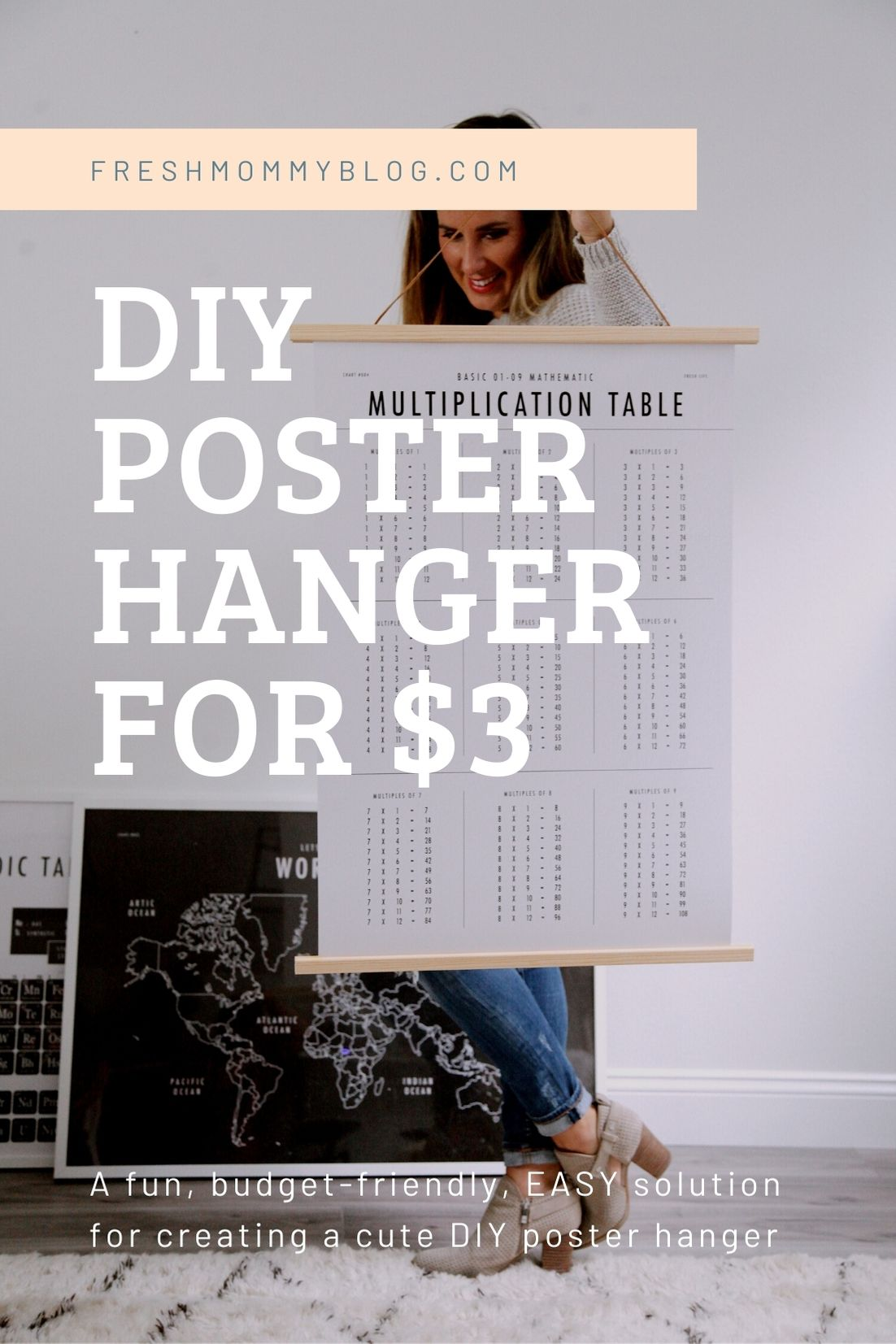 Click through for a fun, EASY DIY poster hanger tutorial. You can make your own  DIY poster hanger for $3 in just a few short minutes! | DIY Poster Hanger by popular Florida DIY blog, Fresh Mommy Blog: Pinterest image of Tabitha Blue holding a DIY poster hanger.